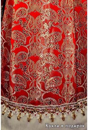 Красная с золотом ткань шубы Дед Мороза